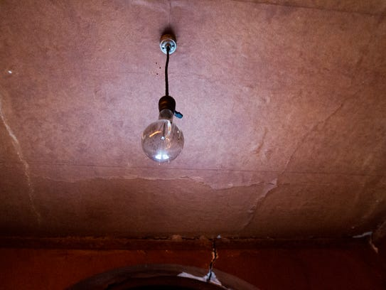 Vintage bulbs and lighting are above a stage in the