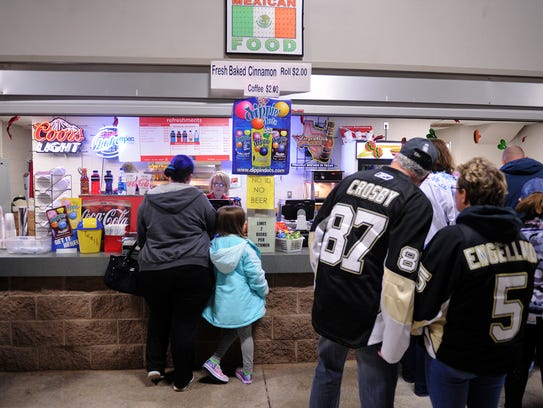 Hockey fans line up to buy snacks before the start