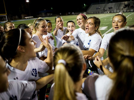 The Barron Collier girls soccer team cheers before the Class 3A regional quarterfinal at Barron Collier High School on Tuesday.