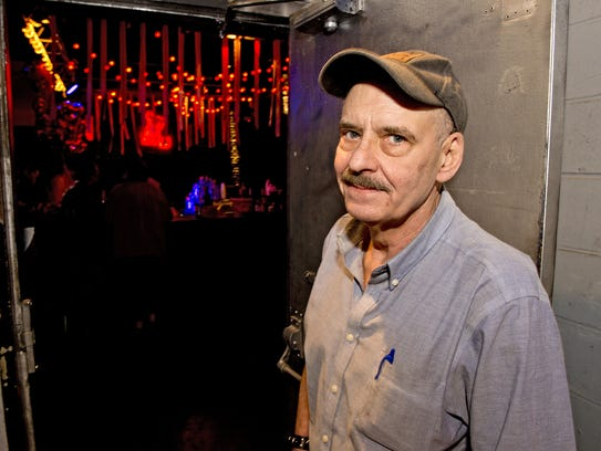 Dock owner Rob Corman stands at the door of his club
