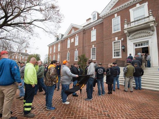 Second Amendment supporters wait in line to enter Legislative Hall in Dover to talk with legislators about gun rights in Delaware.