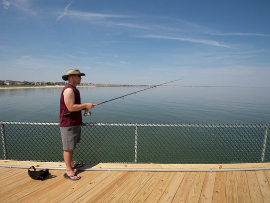 Tosh Tryon of Lewes fishes for flounder at the fishing