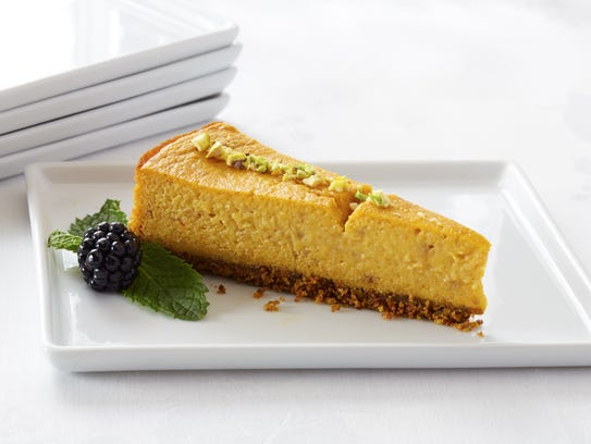 Servings of Pumpkin Pistachio Cheesecake are garnished