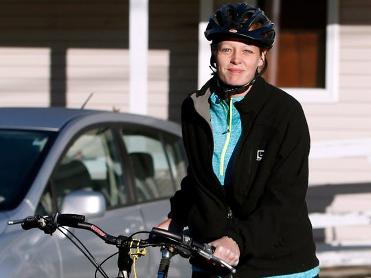 Nurse Kaci Hickox leaves her home on a rural road in Fort Kent, Maine, to take a bike ride with her boyfriend Ted Wilbur, Thursday, Oct. 30, 2014.  The couple went on an hour-long ride followed by a Maine State Trooper.  State officials are going to court to keep Hickox in quarantine for the remainder of the 21-day incubation period for Ebola that ends on Nov. 10. Police are monitoring her, but can't detain her without a court order signed by a judge.