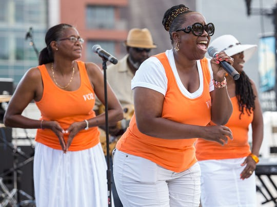 Terry Woody sings with the Voices of Zion during a gospel concert in Tubman Garrett Riverfront Park during the August Quarterly 2014.