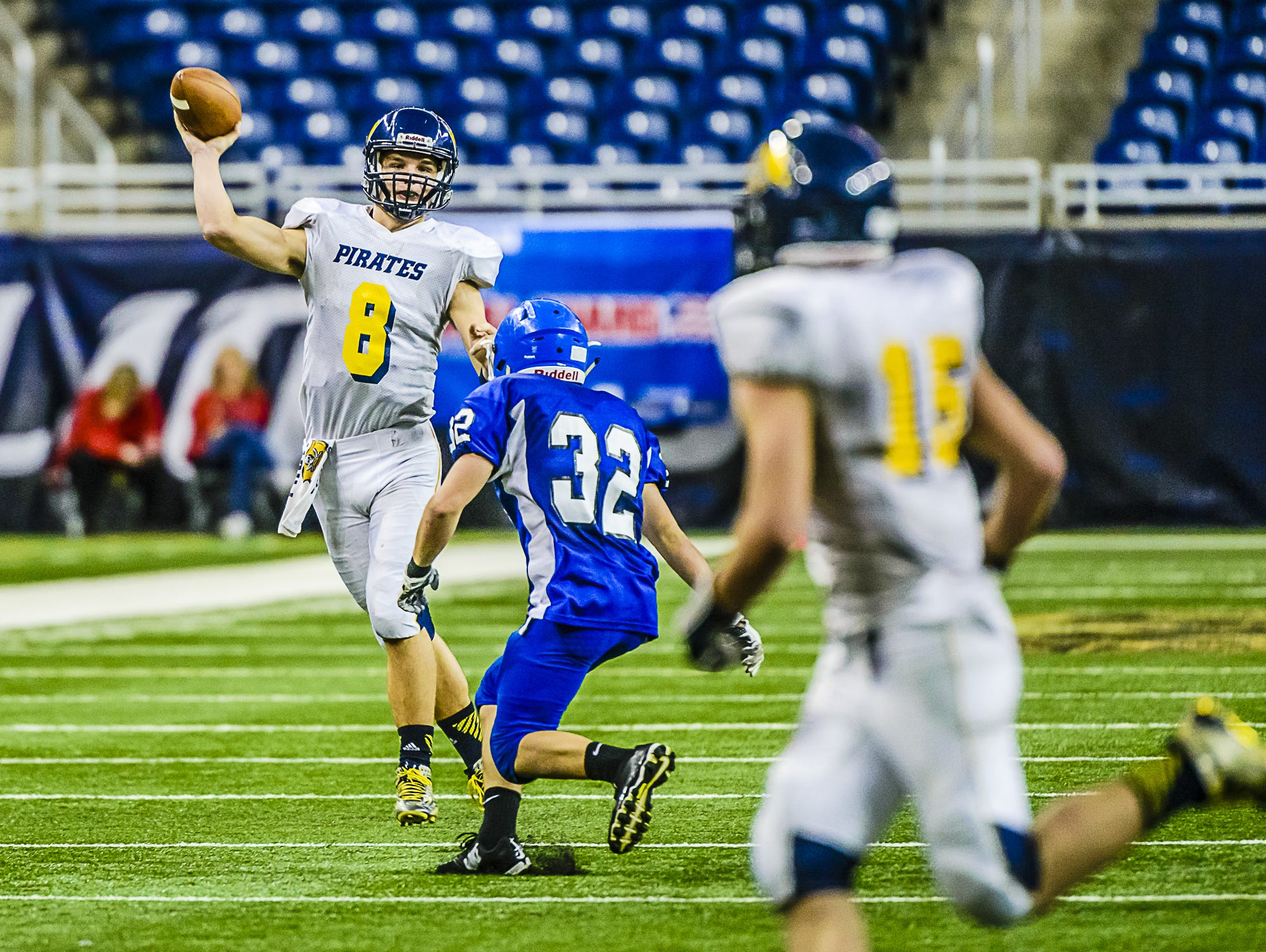 Pewamo-Westphalia quarterback Jimmy Lehman delivers a pass during last year's state championship game. Lehman is one of several playmakers the Pirates have aside from record-setting rusher Jared Smith.