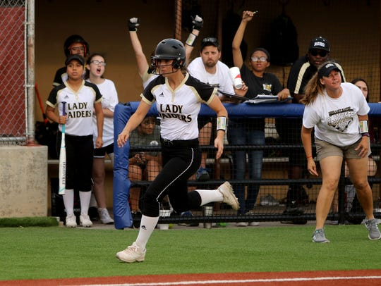 Rider's Madeline Naylor runs home in the playoff game