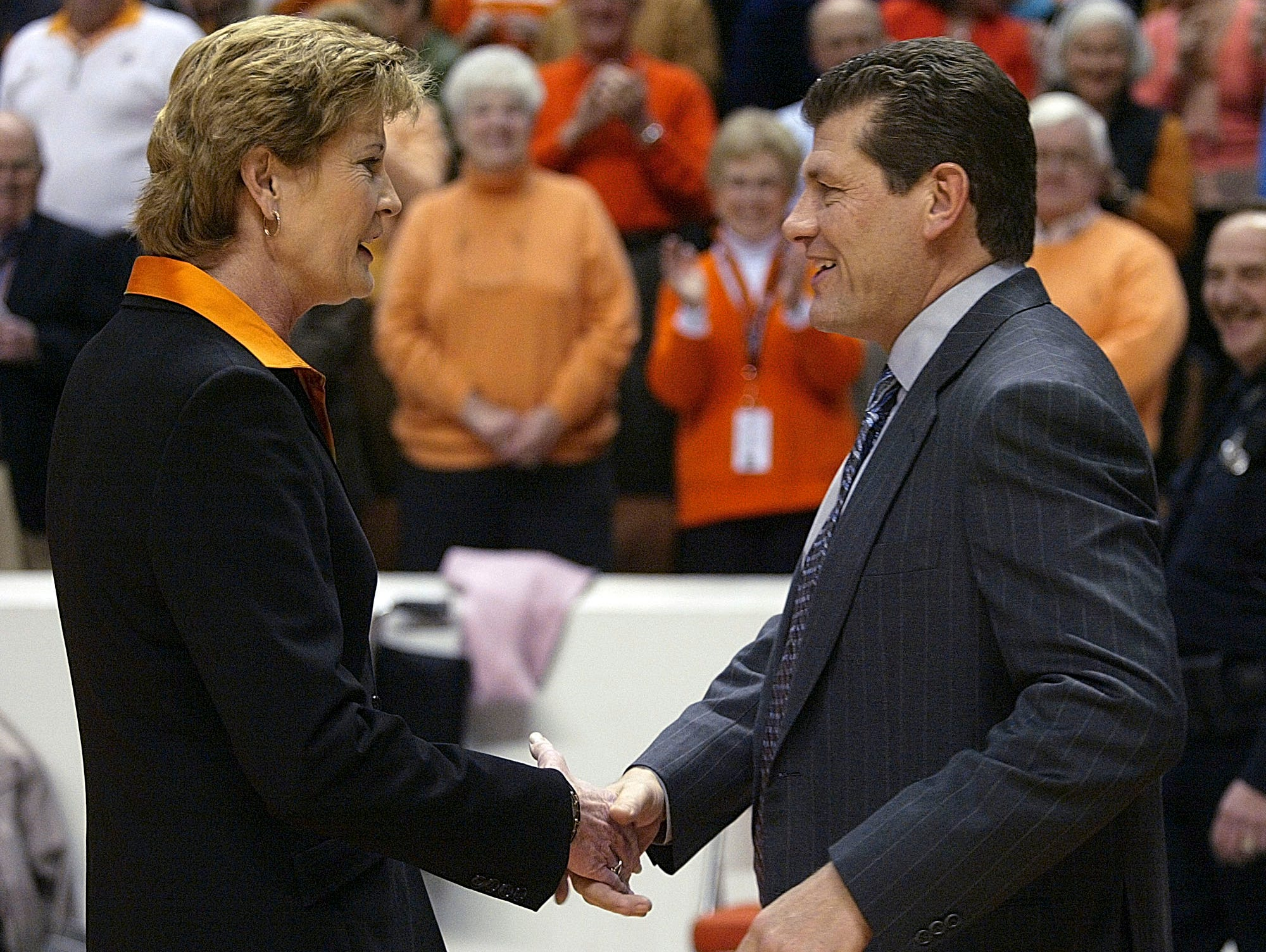 Tennessee coach Pat Summitt, left, shakes hand with Connecticut coach Geno Auriemma before their women's college basketball game in this Jan. 7, 2006 file photo in Knoxville, Tenn. The two schools meet against this weekend. (AP Photo/Wade Payne)