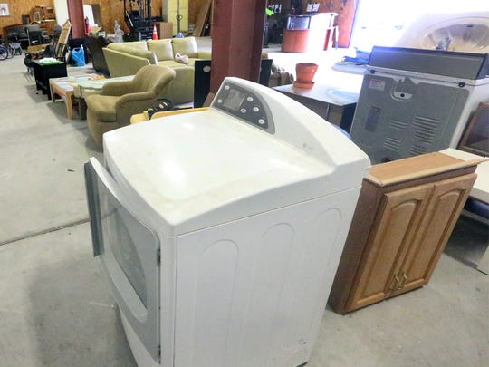A clothes dryer is among the items offered for free