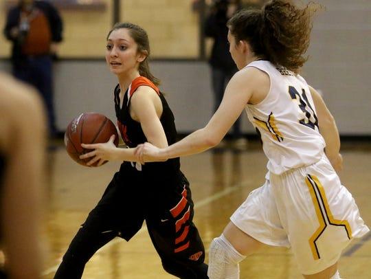 Burkburnett's Sarah Nolan passes by Stephenville's