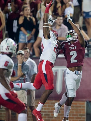 South Alabama Darian Mills (21) swats the ball away from Troy wide receiver John Johnson (2) during the Troy vs South University NCAA football game on Wednesday, Oct. 11, 2017, in Troy, Ala. South Alabama defeated Troy 19-8.