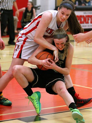 Penfield's Emma Guy (top) tries to wrestle the ball away from Rush-Henrietta's Sarah Sweazy during a game last season.