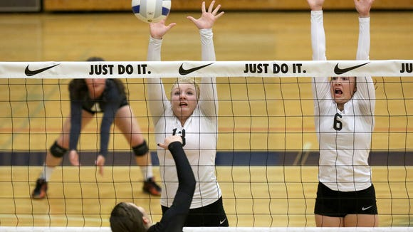 Silverton High School's Rachel Renfrow (13) and Kayce McLaughlin (6) goes up for a block against a Summit hitter during their first round game in the OSAA Class 5A state volleyball tournament on Friday, Nov. 6, 2015, in Hillsboro, Ore.