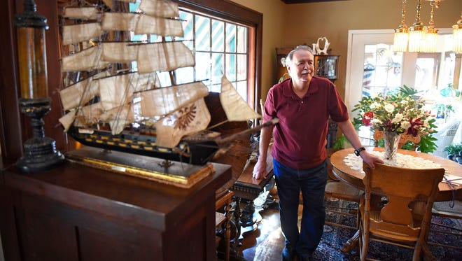 Dale Olson talks about the work he and wife Phyllis have done to restore furniture and antiques Monday, March 28, at Olson's House of Oldies in Waite Park.