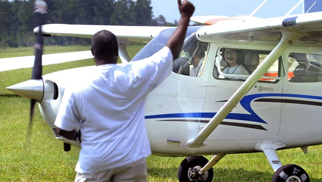Past Chappie James Flight Academy student Catalina Rios takes off with flight instructor Eric Landgraf at Ferguson Airport. The week-long program returns this week.