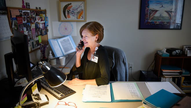 Lead admissions counselor Carolyn Martin talks on the telephone Wednesday, July 19, at St. Cloud Hospital Recovery Plus. When fully launched, the additions of addiction treatment to the Fast Tracker system will make it easier for people to find treatment centers with openings.
