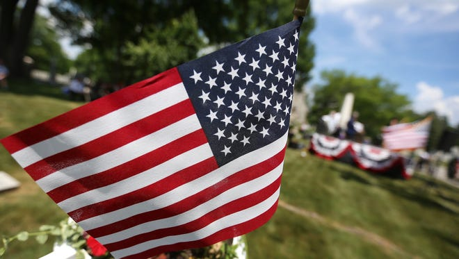 An American flag waves in the breeze during the 150th Observance of Memorial Day at Crown Hill National Cemetery, Monday, May 28, 2018.