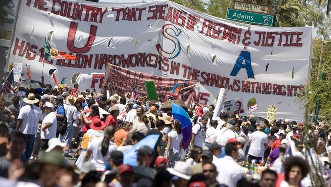 164889 Immigrally29 5/29/10 Thousands participate in an immigration rally from Steele Indian School Park to the Arizona State Capitol in Phoenix. The crowd gathers at the State Capitol to listen to a number of speakers. Photo by Cheryl Evans/ THE ARIZONA REPUBLIC