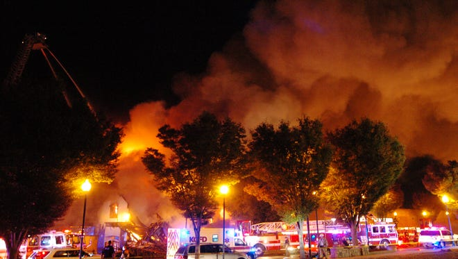 CORRECTS STREET NAME TO INDEPENDENCE AVENUE, NOT INDEPENDENCE BOULEVARD - A fully-engulfed fire burns on Independence Avenue near Prospect in Kansas City, Mo., Monday, Oct. 12, 2015. (T. Rob Brown/The Kansas City Star via AP)