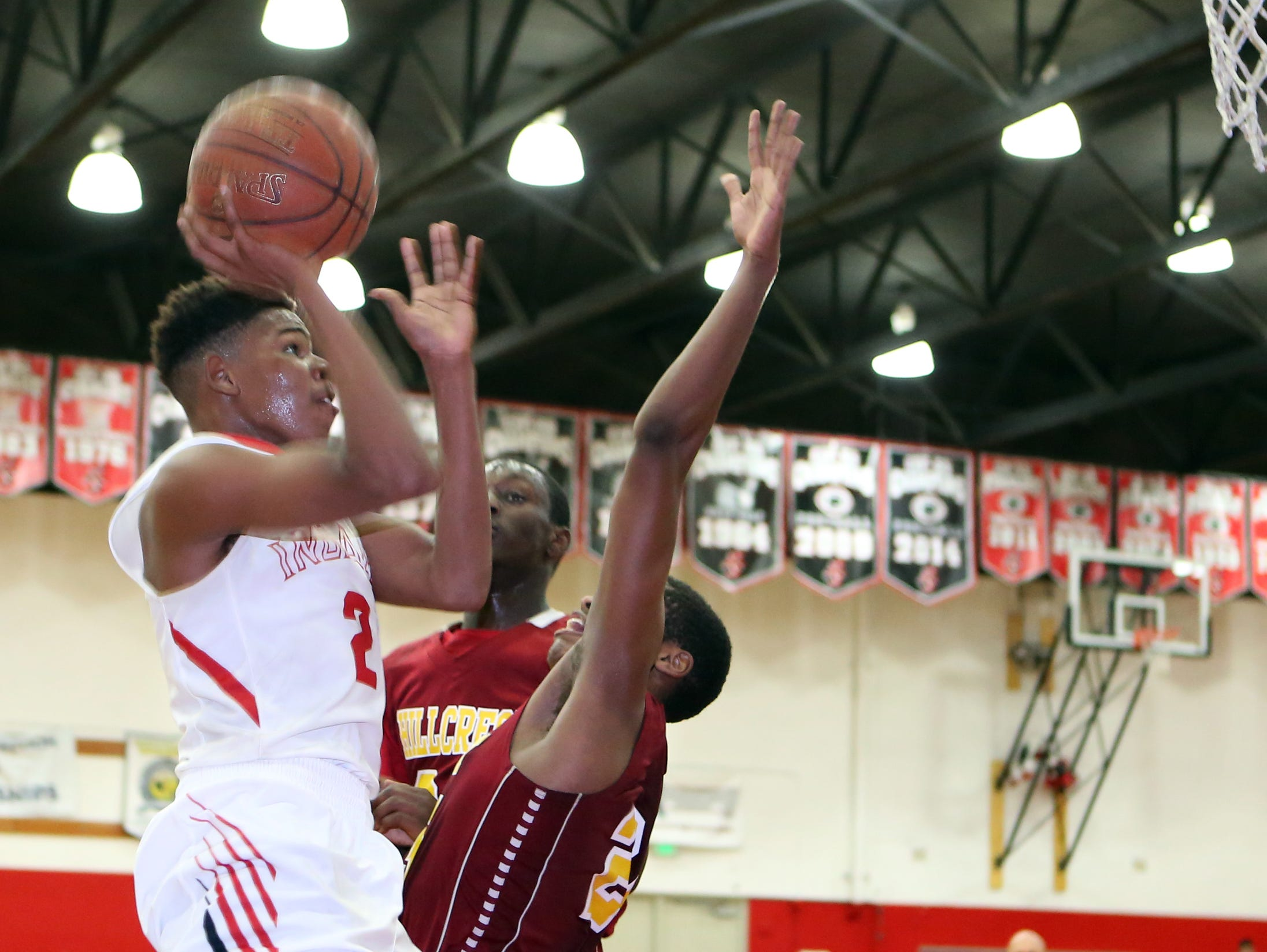 Palm Springs' John Rich drives to the basket during the playoff game against Hillcrest in Palm Springs on Wednesday.