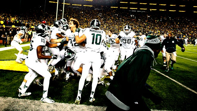 Michigan State celebrates Jalen Watts-Jackson  game-winning touchdown after he picked up a muff punt in the final 10 seconds of MSU's 27-23 win Saturday, Oct. 17, 2015 in Ann Arbor.