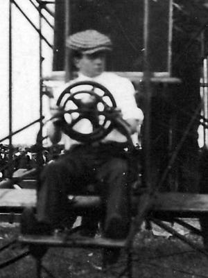 Pal Peck at the wheel of his biplane just before his Chambersburg flight.