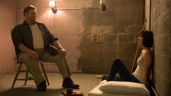 "Mary Elizabeth Winstead, right, and John Goodman in a scene from ""10 Cloverfield Lane."""