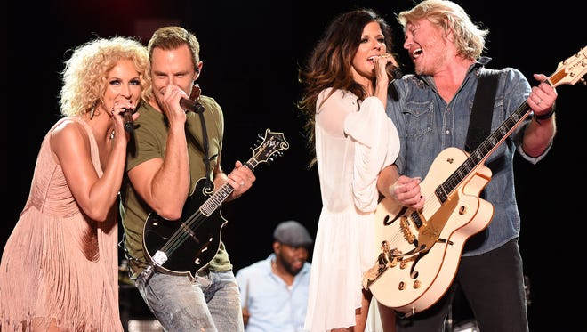 C Flanigan,  FilmMagic NASHVILLE, TN - JUNE 13:  (L-R) Musicians Kimberly Schlapman, Jimi Westbrook, Karen Fairchild and Phillip Sweet of Little Big Town perform onstage during the 2015 CMA Festival on June 13, 2015 in Nashville, Tennessee.  (Photo by C Flanigan/FilmMagic) ORG XMIT: 559378679 ORIG FILE ID: 477084516
