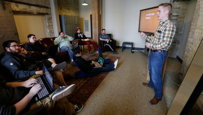 DevCodeCamp lead instructor Ben Towal teaches a class at an intensive computer coding boot camp in March 2016.