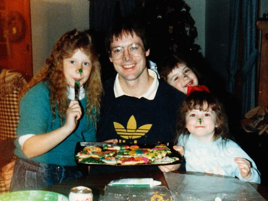 Sasha Anderson, from left, Bill Kautzer, Gabi Koren and Courtney Berg have fun with frosting for Kautzer's 34th birthday. The girls were 9, 6, and 4 at the time.