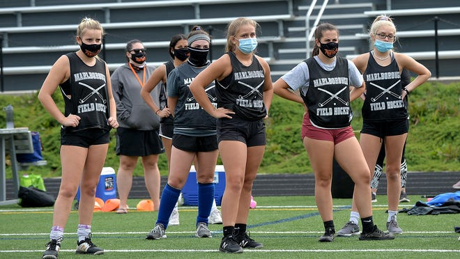 Marlborough field hockey players listen to head coach Mel Melkonian during practice at the middle school last week prior to practices being forced to go remote due to COVID-19 concerns. Fall sports will resume in-person practices on Monday.