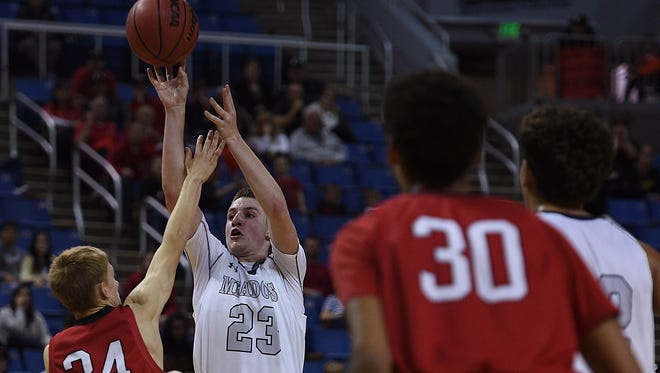 The Meadows' Jake Epstein (23) shoots over Pershing County's Lane Condie during their basketball game at Lawlor Events Center on Friday.