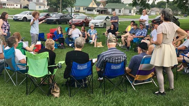 Residents from the area discuss a variety of national and local topics during the Concerned Citizens of Franklin County's public forum held the evening of Aug. 1.