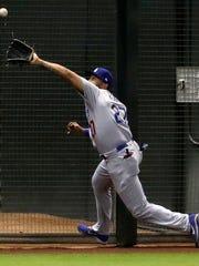 Matt Kemp makes a catch Monday night he likely would