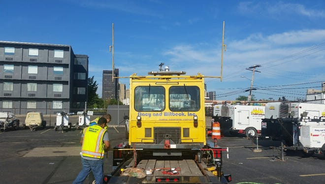 A small, motorized vehicle called a speeder will travel along a section of track in downtown Detroit Tuesday 8/23 as part of testing for the QLINE, the streetcar line being built on Woodward Avenue in downtown Detroit. courtesy M-1 Rail.