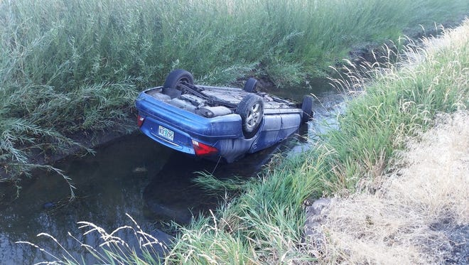 Passing motorists pulled a driver from a vehicle near Prineville.