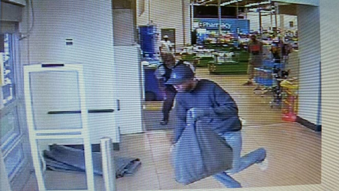 Cameras capture a suspect in the Loomis armored car robbery at the Wal-Mart at 6990 E. Shelby Drive.