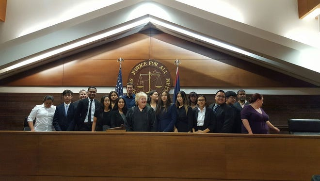 The Notre Dame Mock trial team, with Chief Justice Katherine Maraman. The Royals will compete in the national mock trial event.