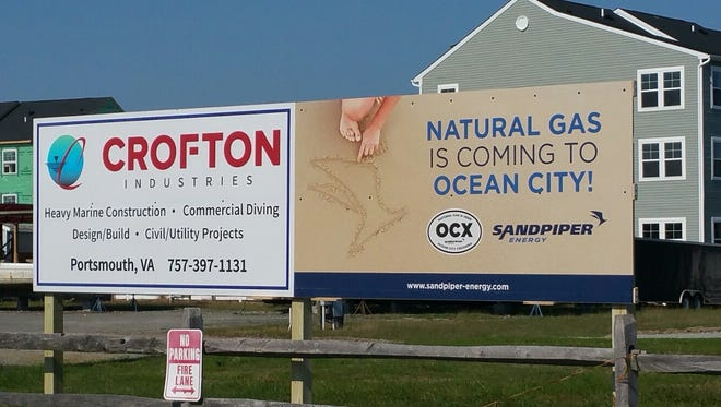 Signs advertising natural gas is coming to Ocean City.