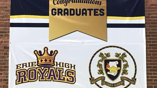 The Erie School District is organizing a public round of applause for its graduating seniors, which the district is also honoring with banners. This one, shown Tuesday, hangs outside the Patrick J. DiPaolo Student Success Center, which houses the district's alternative education programs at the former Emerson-Gridley School building. High school students attend the programs.
