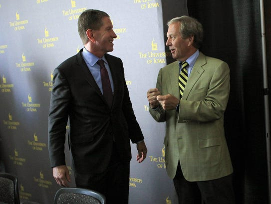 Iowa Board of Regents President Bruce Rastetter, left,