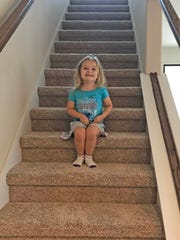 Isabella loves navigating the stairs in her new home.