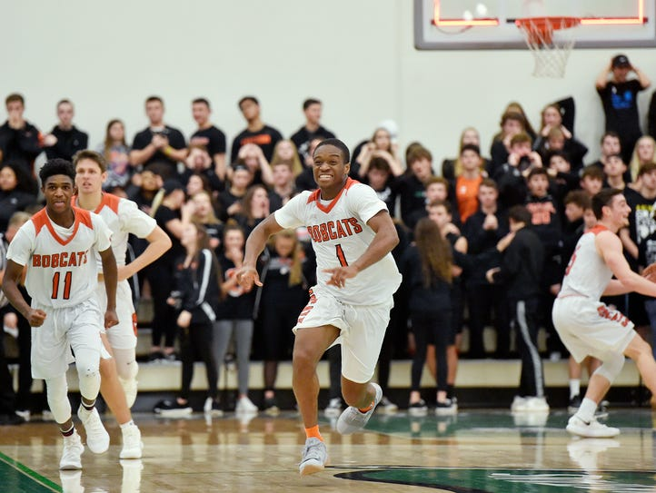 Northeastern's Fred Mulbah, center, celebrates at the