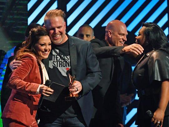 MercyMe celebrates their Artist of the Year Award at