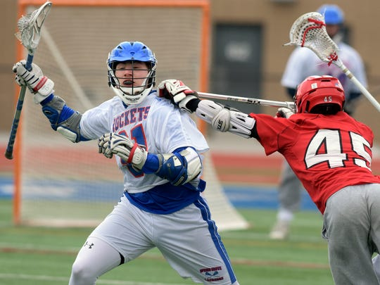 Spring Grove's Cameron Back gets pressure from Susquehannock's Ian LeBlanc during lacrosse action at Spring Grove Thursday, April 19, 2019 Bill Kalina photo