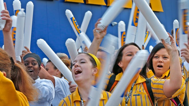 IKEA Fishers staff cheers as they march in, ready to open the store, at the IKEA Fishers grand opening, Wednesday, Oct. 11, 2017.
