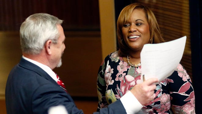 Pelicia Hall, acting Commissioner of the Mississippi Department of Corrections, right, takes advantage of her visit to the Legislature to corral House Corrections Committee chairman Bill Kinkade, R-Byhalia, for a quick conference off the floor during floor debate on a number of bills, Tuesday, Feb. 7, 2017.