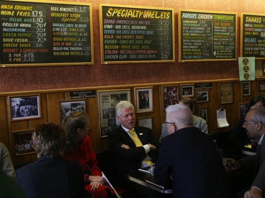 Former President Bill Clinton listens to a question during an unscheduled stop for breakfast at Hamburg Inn No.2 before attending an event in Muscatine, Tuesday November 27, 2007 in Iowa City, Iowa.