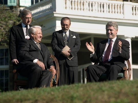 During a one-day summit at the Franklin D. Roosevelt National Historic Site in 1995, Russian President Boris Yeltsin and President Bill Clinton discuss their views behind the Home of FDR National Historic Site.