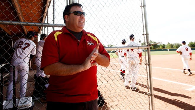 Kurt Colicchio, the owner and general manager of the Fort Collins Foxes, makes sure both teams are ready for the start of a 2014 game at Chimney Park in Windsor. The Foxes begin their 14th season as a summer collegiate baseball team with a home game Friday evening at Fort Collins' City Park.
